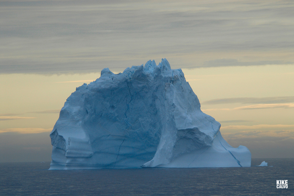 Icebergs from Greenland, drifting on Iceberg Alley. Baffin Bay.  Baffin Island. High Arctic. Canada<br /> ( environment, global warming, ice, snow, white, blue, turquoise, inmense, mass, block, glacier, foggy, fog, ocean, arctic circle, winderness, view, trip, exploration, wild, scenic, scenics, seascape, tourist, cold.