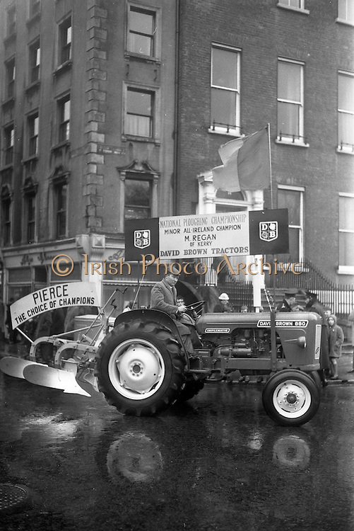17/03/1963<br /> 03/17/1963<br /> 17 March 1963<br /> M. Regan, Minor All-Ireland Ploughing Champion from Co, Kerry on a David Brown 880 tractor in the N.A.I.D.A. St. Patricks Day Parade, Dublin.