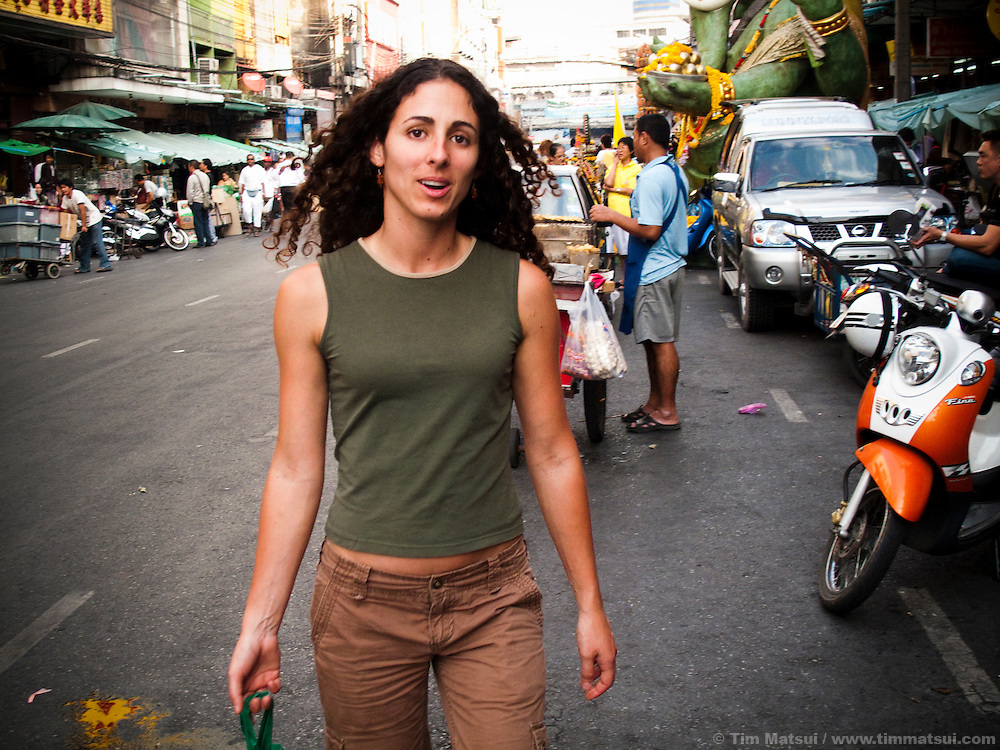 A caucasian woman on the streets of the Phahurat neighborhood, Bangkok, Thailand.