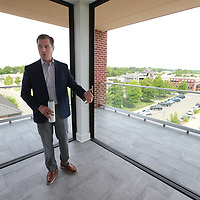 Brent Waldrop enjoys the view of Tupelo's Fairpark District froom the fourth floor of the new Fairpark Tower.