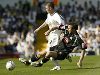Photo: Aidan Ellis.<br /> Leeds United v Plymouth Argyle. Coca Cola Championship. 07/04/2007.<br /> Leeds David Healy (L) is brought down by Plymouth's Kriztian  Timar