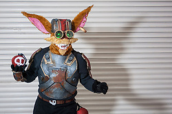 © Licensed to London News Pictures. 14/03/2015. Newham, London, UK.  A man dressed as Ziggs from League of Legends, one of many cosplayers attending the London Comic Con at the Excel Centre in Docklands. Photo credit : Stephen Chung/LNP