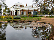 "Monticello reflects in a pond. Monticello, near Charlottesville, Virginia, was the estate of Thomas Jefferson, the principal author of the United States Declaration of Independence, the third President of the United States, and founder of the University of Virginia. Monticello is Italian for ""little mountain."" Jefferson designed the house himself on the summit of an 850-foot (260 m)-high peak in the Southwest Mountains south of the Rivanna Gap. An image of the west front of Monticello appeared on on the US two dollar bill printed from 1928 to 1966, and on the US nickel (5-cent coin made from 1938 to 2003, and from 2006 onwards). Monticello was designated a World Heritage Site in 1987, an honor it shares with the nearby University of Virginia."