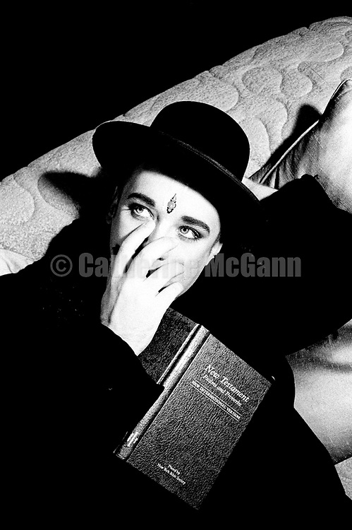 "NEW YORK - March 1993:  British singer Boy George poses for a portrait holding the ""New Testament Psalms and Proverbs"" in March 1993 in New York City, New York (Photo by Catherine McGann)Copyright 2010 Catherine McGann"