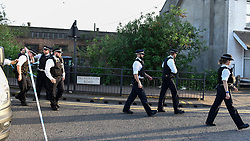 © Licensed to London News Pictures. 06/05/2018. LONDON, UK.  Police arrive at Palmerston Road in Wealdstone, near Harrow, north west London, following reports of two separate shooting incident around midday on Sunday 6 May 2018.  The two victims are a 12 year old boy and a15 year old boy.  Investigations are ongoing.  Photo credit: Stephen Chung/LNP