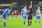 Brighton defender, full back, Inigo Calderon (14) recieves yellow card during the The FA Cup match between Hull City and Brighton and Hove Albion at the KC Stadium, Kingston upon Hull, England on 9 January 2016. Photo by Ian Lyall.