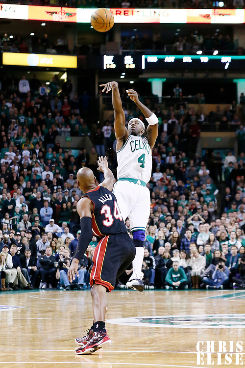 27 January 2013: Boston Celtics shooting guard Jason Terry (4) takes a jumpshot over Miami Heat shooting guard Ray Allen (34) during the Boston Celtics 100-98  2OT victory over the Miami Heat at the TD Garden, Boston, Massachusetts, USA.