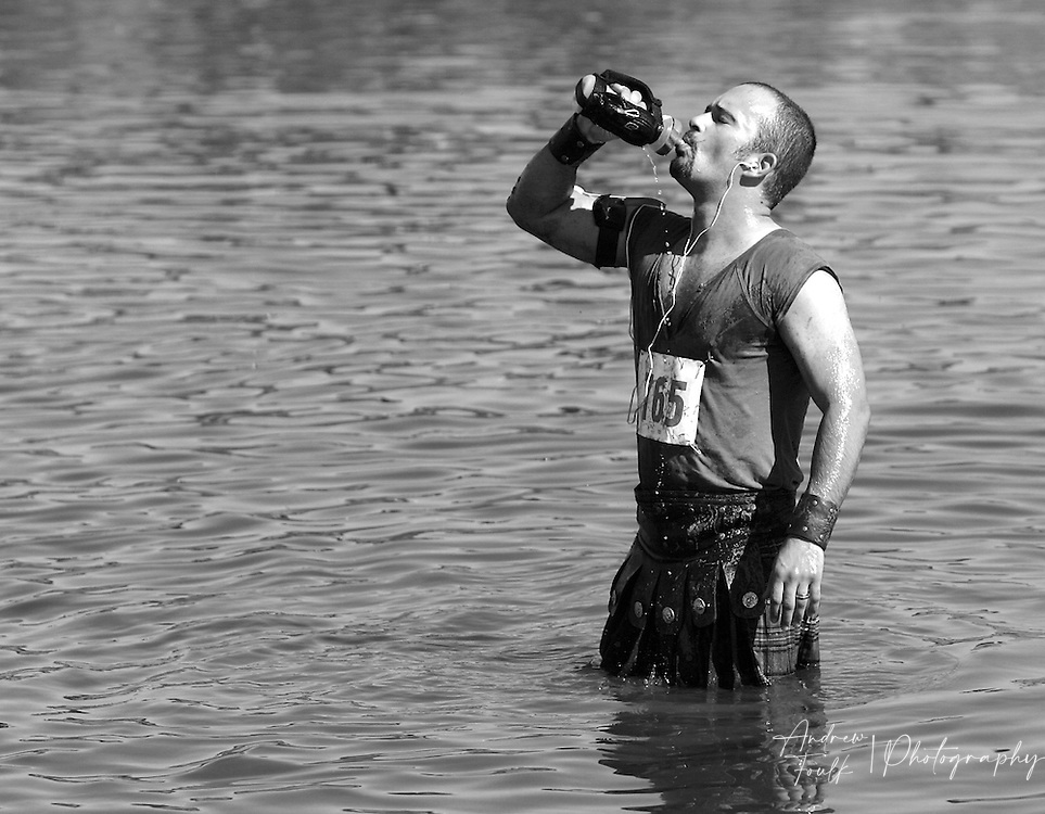 /Andrew Foulk/ For The Californian/ .Eric Lisker, of Orange County, dressed as a Gladiator takes a drink of water as he cleans off in Lake Elsinore after competing in the Lake Elsinore Gladiator Run.