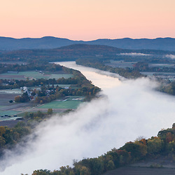 The Connecticut River at dawn as seen from South Sugarloaf Mountain in the Sugarloaf Mountain State Reservation in Deerfield, Massachusetts.