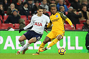 Erik Lamela of Tottenham Hotspur (11) battles for possession with Brighton and Hove Albion defender Gaetan Bong (3) during the Premier League match between Tottenham Hotspur and Brighton and Hove Albion at Wembley Stadium, London, England on 13 December 2017. Photo by Matthew Redman.
