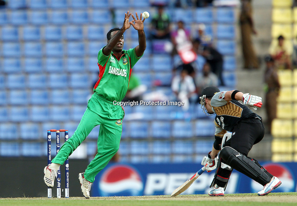 Elias Sunny fields from his own bowling during the ICC World Twenty20 Pool match between New Zealand and Bangladesh held at the  Pallekele Stadium in Kandy, Sri Lanka on the 21st September 2012<br /> <br /> Photo byRon Gaunt/SPORTZPICS/PHOTOSPORT