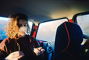 Female smoking in car. UK. 1980s.