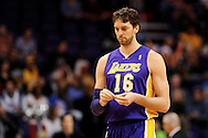 Dec 23, 2013; Phoenix, AZ, USA; Los Angeles Lakers center Pau Gasol (16) walks up the court against the Phoenix Suns at US Airways Center. The Suns won 117-90. Mandatory Credit: Jennifer Stewart-USA TODAY Sports