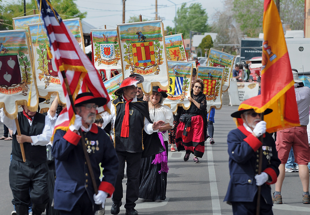 jt040817c/a sec/jim thompson/  Founders' Procession heads towards the Old Town Plaza during the Fiesta de Albuquerque. Saturday April 08, 2017. (Jim Thompson/Albuquerque Journal)