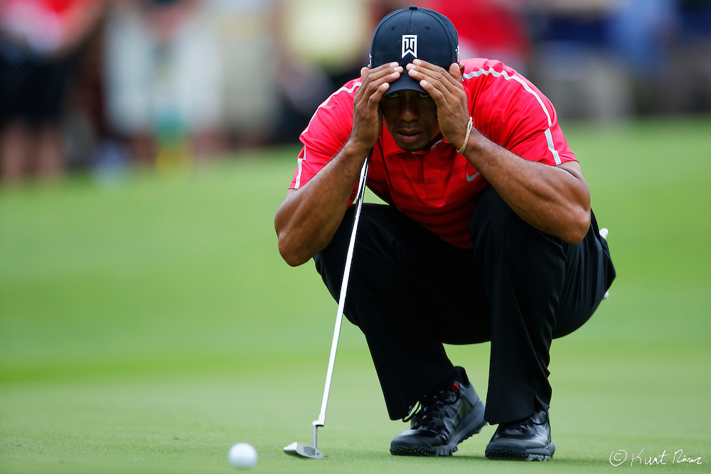 TIGER WOODS prepares for his putt on the second hole during the final round of the Arnold Palmer Invitational at the Bay Hill Club and Lodge.