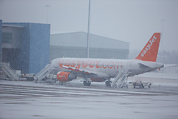© Licensed to London News Pictures. © Licensed to London News Pictures. 19/11/13. Budget airline Easyjet has reported a rise of 50.9% in annual profits to £478m<br /> <br /> FILE PHOTO  14/01/2013. LUTON, UK. An easyJet plane at Luton Airport. The airport has warned that expected heavy snow could cause disruption this afternoon. Photo credit :  Cliff Hide/LNP