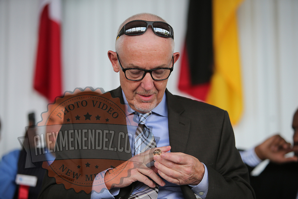 CANASTOTA, NY - JUNE 14: Boxing columnist Nigel Collins puts his hall of fame ring onto his finger during the induction ceremony at the International Boxing Hall of Fame induction Weekend of Champions events on June 14, 2015 in Canastota, New York. (Photo by Alex Menendez/Getty Images) *** Local Caption *** Nigel Collins