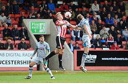 Danny Wright of Cheltenham Town competes with Danny Collins of Grimsby Town for the high ball- Mandatory by-line: Nizaam Jones/JMP - 17/04/2017 - FOOTBALL - LCI Rail Stadium - Cheltenham, England - Cheltenham Town v Grimsby Town - Sky Bet League Two