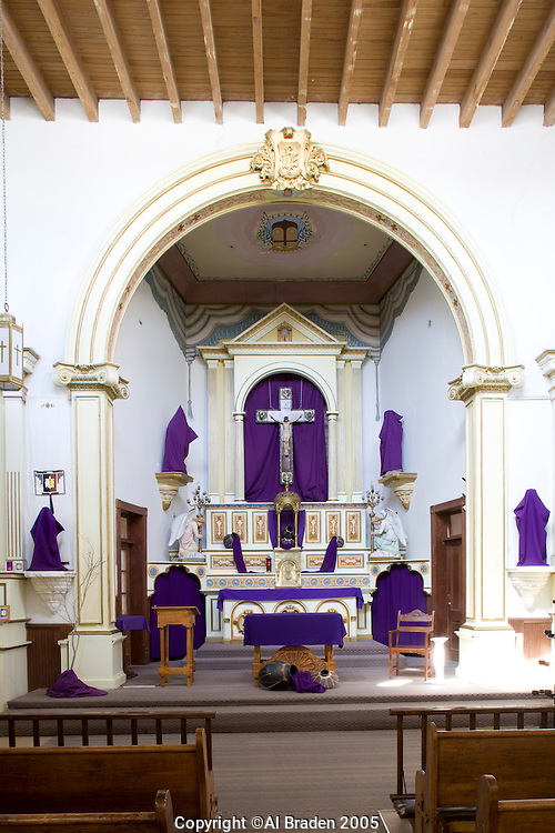 Ysleta del Sur Mission is an historic mission in El Paso, Texas, originally founded in 1682 following the Pueblo Revolt in New Mexico. Altar is drapped in purple during Lent.