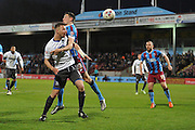 Tom Pope (11) of Bury heads towards goal but missis held by s23\ during the Sky Bet League 1 match between Scunthorpe United and Bury at Glanford Park, Scunthorpe, England on 19 April 2016. Photo by Ian Lyall.
