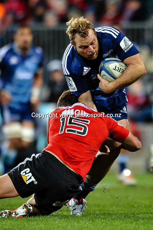 Luke Braid of the Blues is tackled by Israel Dagg of the Crusaders in the Super rugby match,  Crusaders v The Blues, at AMI Stadium, Christchurch, on the 5 July 2014 . Photo:John Davidson/www.photosport.co.nz