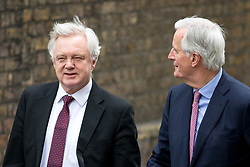© Licensed to London News Pictures. 05/02/2018. London, UK. European Chief Negotiator for the United Kingdom Exiting the European Union Michel Barnier (right) and Secretary of State for Exiting the European Union David Davis arrive in Downing Street for a meeting on Brexit. Photo credit : Tom Nicholson/LNP