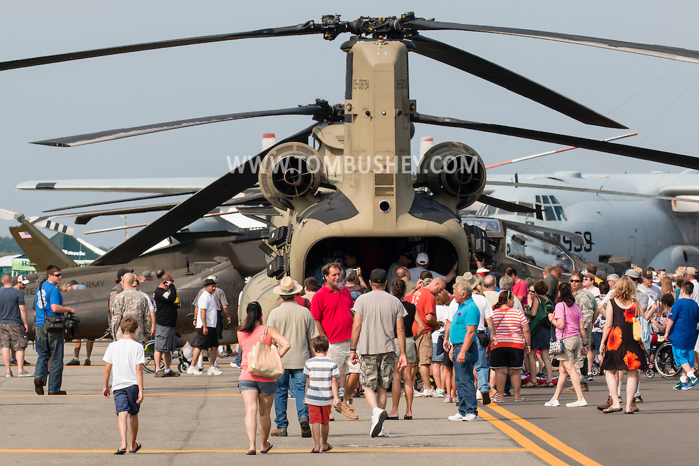 New Windsor, New York - People look at aircraft on static display during the second day of the New York Air Show at Stewart International Airport on Aug. 30, 2015. ©Tom Bushey / The Image Works