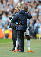 Football - 2013 / 2014 Premier League - Manchester City vs. West Ham United<br /> Manchester City's Yaya Toure hugs manager Manuel Pellegrini following his substitution at the Etihad Stadium, Manchester