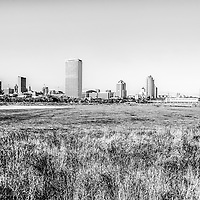 Milwaukee skyline black and white picture. High resolution photo includes Lakeshore State Park, US Bank building, University Club Tower, and Northwestern Mutual Tower. Lakeshore State Park is a Wisconsin State Park near downtown Milwaukee on Lake Michigan.