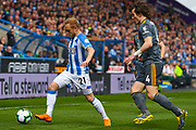 Alex Pritchard of Huddersfield Town (21) and Caglar Soyuncu of Leicester City (4) in action during the Premier League match between Huddersfield Town and Leicester City at the John Smiths Stadium, Huddersfield, England on 6 April 2019.