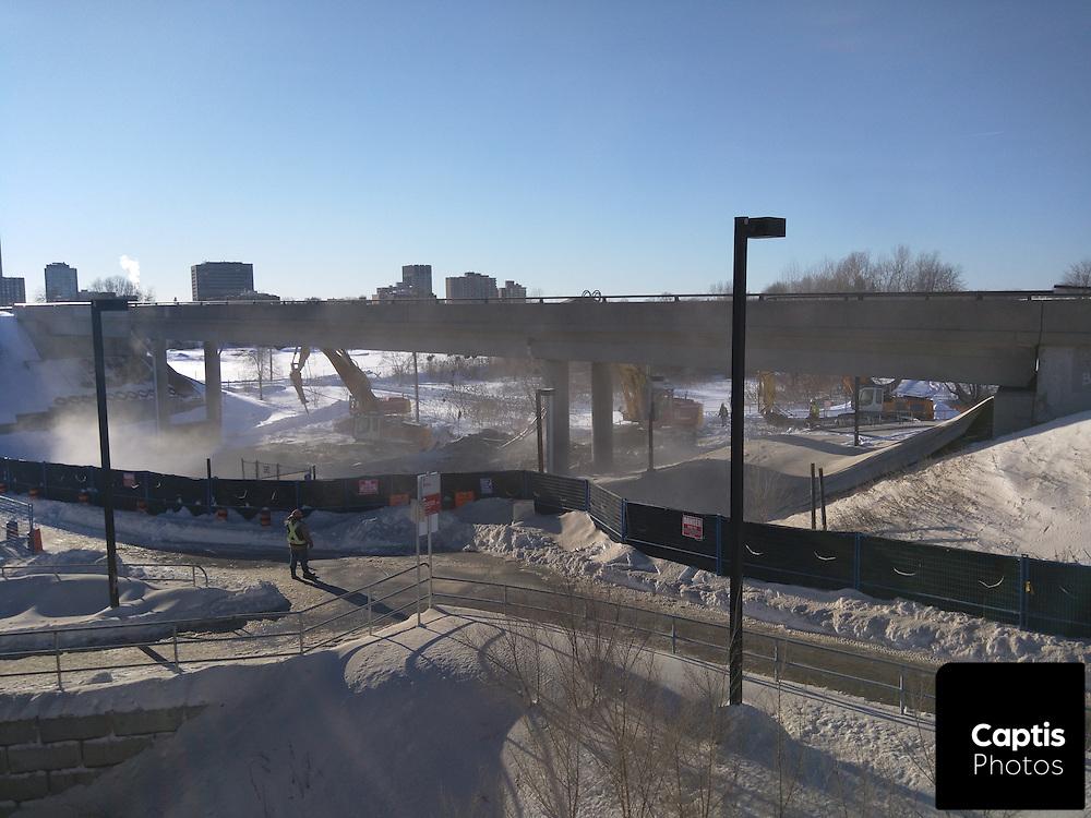 Crews demolish the Bayview Transitway overpass to make way for light rail construction. February 18, 2016. Brendan Montgomery/Captis Photos