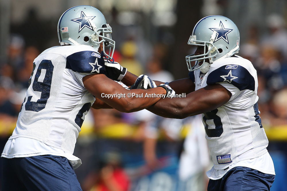 OXNARD, CA - AUGUST 01:  Rookie running back Felix Jones #28 of the Dallas Cowboys arm grapples with rookie running back Tashard Choice #29 during a blocking drill at the 2008 Dallas Cowboys Training Camp at River Ridge Field on August 1, 2008 in Oxnard, California. ©Paul Anthony Spinelli *** Local Caption *** Felix Jones;Tashard Choice