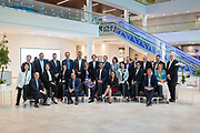 Large Group Image of a group of meeting attendees in a corporate office.