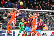 Shrewsbury Town forward Carlton Morris (9) looks to head the ball towards goal  during the EFL Sky Bet League 1 match between Scunthorpe United and Shrewsbury Town at Glanford Park, Scunthorpe, England on 17 March 2018. Picture by Mick Atkins.