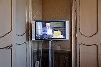 """Palermo, Italy - 20 July, 2012:  A screen displays the live speech of President of Sicilian Regione Raffaele Lombardo, 61, in the press room of the Sicilian Regional Assemby on 20 July, 2012, in Palermo, Italy.<br /> <br /> Mario Monti has expressed """"serious concerns"""" that Sicily's regional government is heading towards default and has asked its governor – who is under investigation for suspected links to the Mafia – to confirm his intention to resign. Sicily was among 23 Italian """"sub-sovereign entities"""" downgraded by Moody's rating agency on Monday, a development that has raised the possibility of a chain of defaults at the local level unless the central government intervenes. Sicily's debt was €5.3bn at the end of 2011, according to Bloomberg. Mr Monti, Italy's technocratic prime minister, indicated in his statement on Tuesday that Rome would take action to bail out Sicily's debts. Sicily has long been identified as one of the most poorly managed of Italy's regions, with the public sector accounting for the bulk of the island's economy and jobs. Commentators call it """"Italy's Greece""""."""