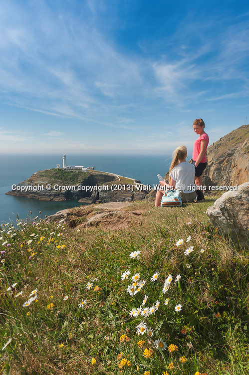Two female walkers above South Stack lighthouse<br /> Near Holyhead<br /> Holy Island<br /> Anglesey<br /> North<br /> Walking<br /> Activities and Sports