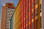 Israel, Tel Aviv, Dan Hotel colourful facade (by Yaacov Agam) on the seafront promenade. Sheraton Hotel in the background .