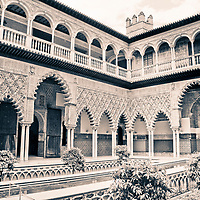 Original color Photograph has be desaturated and has a blue gold tint. - 'Courtyard of the Maidens' or Patio de las Doncellas in the Royal Alc·zar (Palace) of Seville - 'Real Alc·zar de Sevilla'