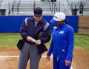 Hampton University Softball Coach Trena Peel goes over her lineup card with Umpire Maggie Christensen prior totheir first game of their during doubleheader split against Morgan State University at the Lady Pirates Softball Complex on the campus of Hampton University in Hampton, Virginia.  (Photo by Mark W. Sutton)