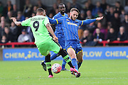Callum Kennedy of AFC Wimbledon battles with Keanu Marsh-Brown during the The FA Cup match between AFC Wimbledon and Forest Green Rovers at the Cherry Red Records Stadium, Kingston, England on 7 November 2015. Photo by Stuart Butcher.