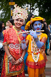 © Licensed to London News Pictures. 09/06/2013. London, UK. Young followers of the Here Krishna Movement are seen wearing traditional dress in Hyde Park, London, today (09/06/2013) as part of the 'Hare Krishna' festival of 'Rathayatra'. The parade, also known as the 'Festival of Chariots', is the biggest street festival celebrated by members of the Krishna followers and, in London, features three huge, wooden chariots containing the smiling figures of Lord Jagannatha, Lady Subhadra and Lord Balarama being pulled by hand from Hyde Park to Trafalgar Square.  Photo credit: Matt Cetti-Roberts/LNP