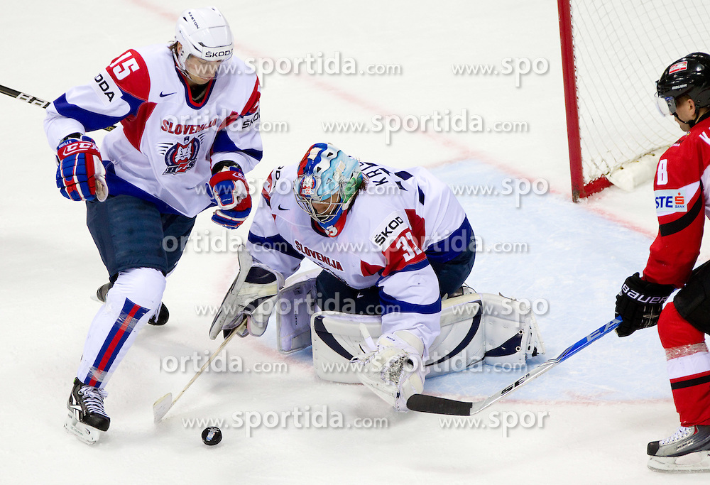 Blaz Gregorc of Slovenia, Robert Kristan, goalkeeper of Slovenia and Roland Kaspitz of Austria during ice-hockey match between Austria and Slovenia of Group G in Relegation Round of IIHF 2011 World Championship Slovakia, on May 7, 2011 in Orange Arena, Bratislava, Slovakia. Austria defeated Slovenia 3-2. (Photo By Vid Ponikvar / Sportida.com)