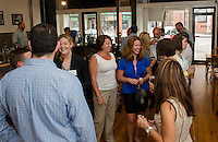 Debbie Myrick Bolduc introduces Colleen Thomas to Fusion President Jaimie Sousa during Fusion's networking event held at Wayfarer Coffee Roasters on Tuesday morning.  (Karen Bobotas/for the Laconia Daily Sun)
