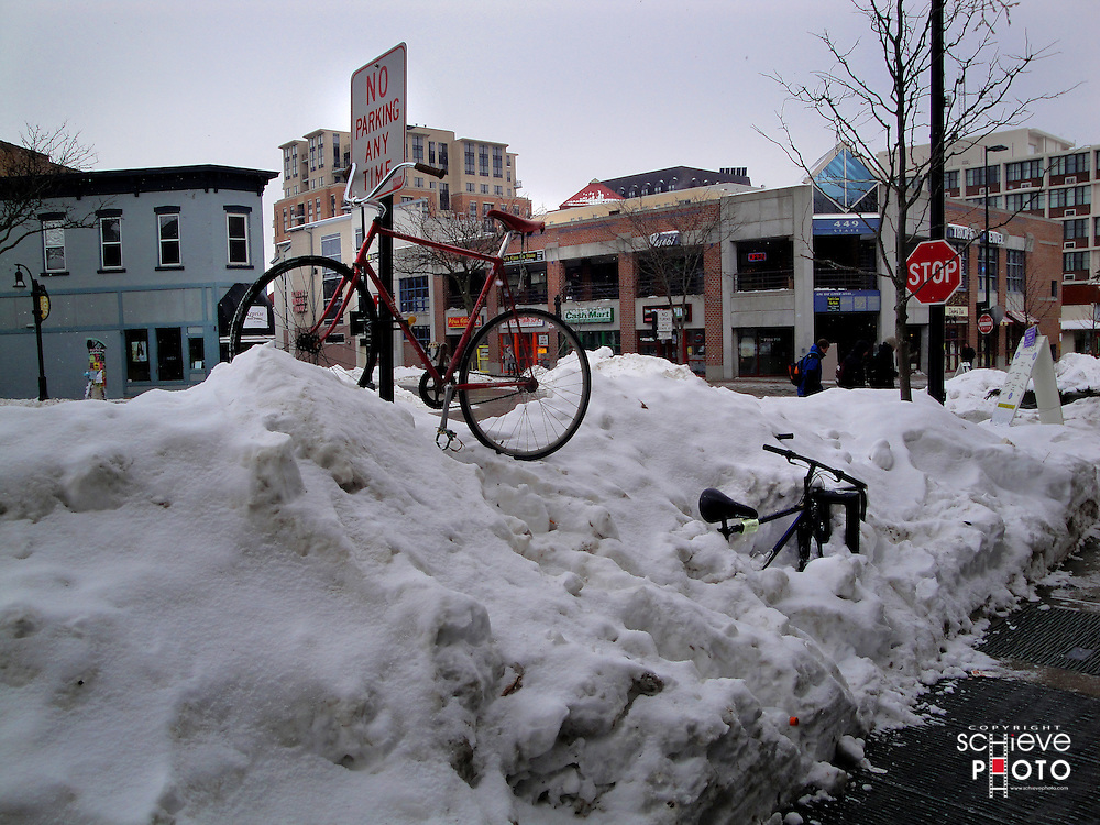 Bicycle on a snow bank.