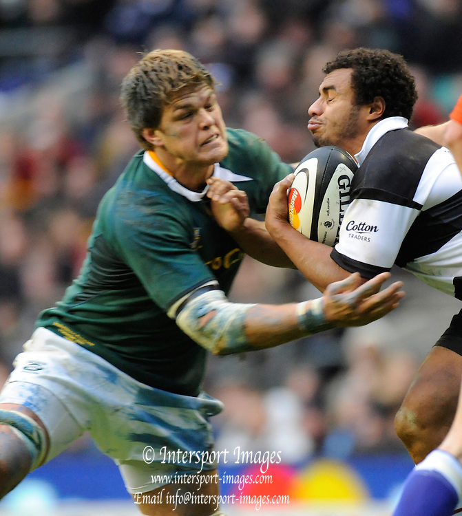 """Twickenham; GREAT BRITAIN; right,  Will GENIA, tackled by Juan SMITH, during the MasterCard Trophy; Barbarians [Baa Baa's] vs South Africa;  at Twickenham Stadium; Surrey on Saturday  - 04/12/2010   [Mandatory Credit; """"Photo, Peter Spurrier/Intersport-images']"""