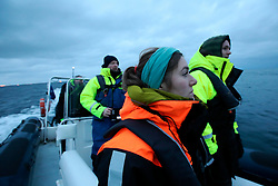 NORWAY ANDENES 8DEC15 - Greenpeace campaigners Larissa Baeumer of Germany and Erlend Tellnes (R) of Norway during a whale research boat trip off the coast of Andenes, Norway.<br /> <br /> jre/Photo by Jiri Rezac / Greenpeace<br /> <br /> © Jiri Rezac 2015
