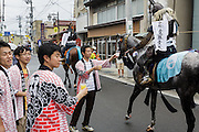 Soma, Fukushima prefecture, July 25 2015 - Parade on the streets of Soma during Nomaoi, a festival of samurai riding horses.<br /> The Soma nomaoi is said to be a 1000-year-old traditional festival. It was held in 2011, a few months after the nuclear disaster, but only a few local horses were available.