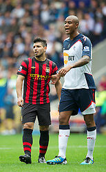21.08.2011, Reebok Stadium, Bolton, ENG, PL, Bolton Wanderers FC vs Manchester City FC, im Bild Bolton Wanderers' Zat Knight towers above Manchester City's diminutive Sergio Aguero during the Premiership match at the Reebok Stadium, EXPA Pictures © 2011, PhotoCredit: EXPA/ Propaganda/ D. Rawcliffe *** ATTENTION *** UK OUT!