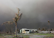 Hotel Under A Volcanic Eruption In Tavurvur Volcano, Rabaul, New Britain Island, Papua New Guinea.