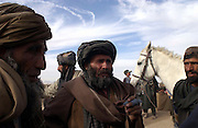 Anti-Taliban fighters in Kandahar, days after the fall of the Taliban. US airforce jet contrails are clearly visible in the sky.